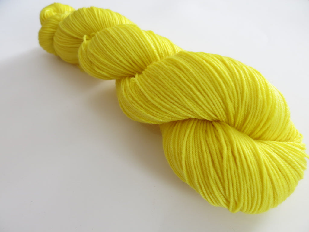 solid yellow sock yarn skein for knitting and crochet