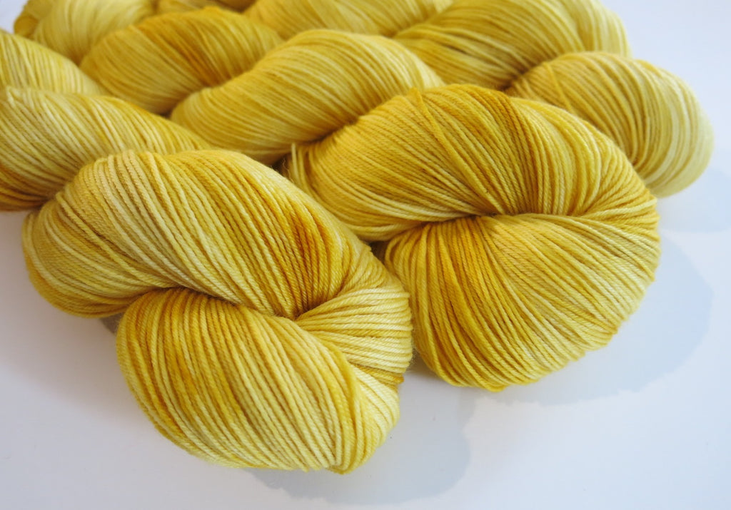 golden yellow tonal yarn skeins for knitting socks