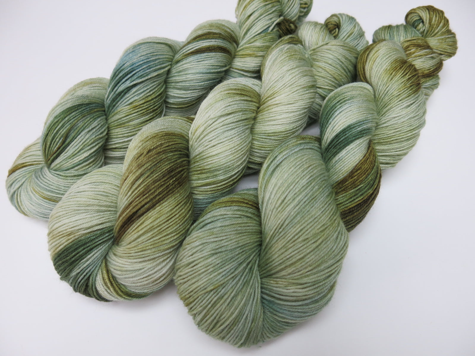 hand dyed tonal sea glass green and blue sock yarn
