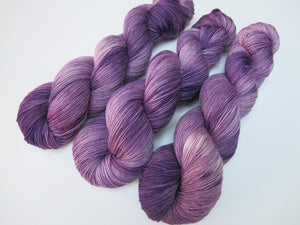 kettle dyed tonal purple merino sock yarn skeins