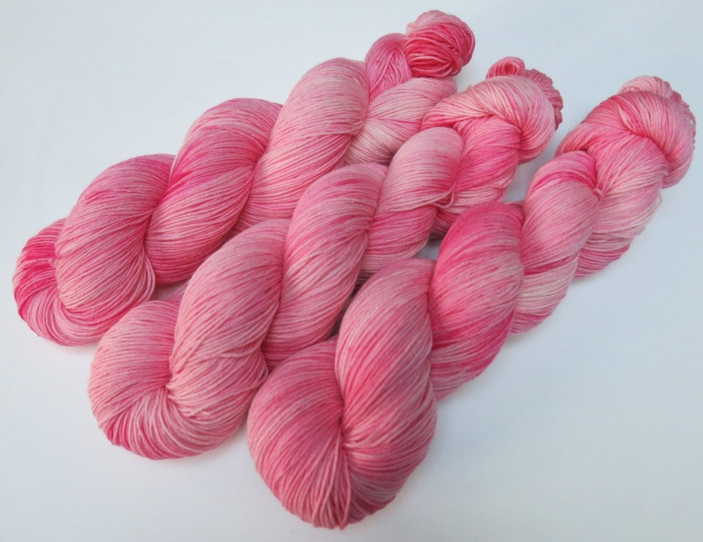 tonal pink yarn skein for knitting socks and shawls