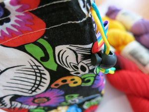 hand sewn drawstring bag with day of the dead sugar skulls and flowers