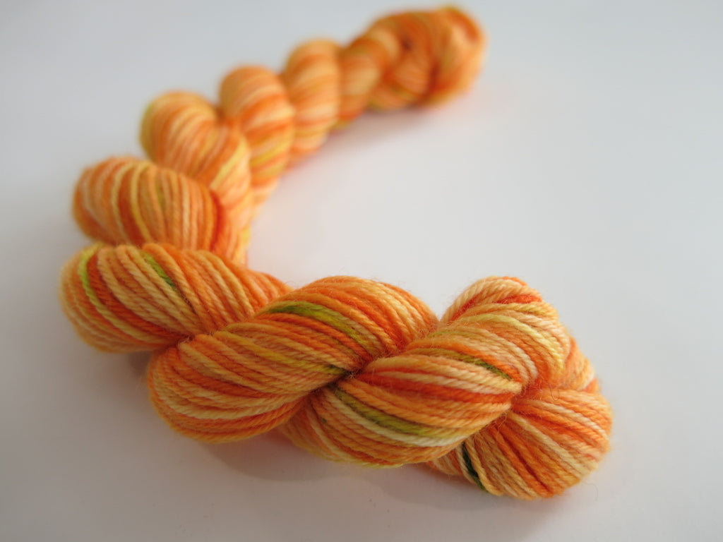halloween pumpkin sock yarn that glows under uv black light