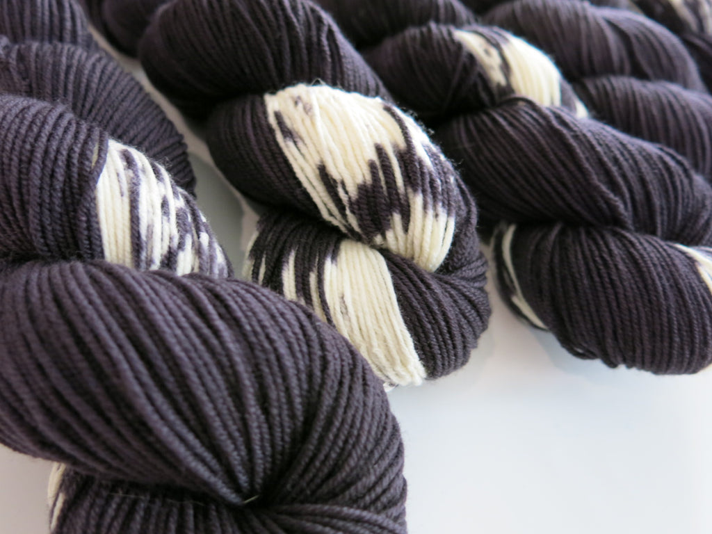 black and white fairy cat inspired 8ply merino yarn skeins