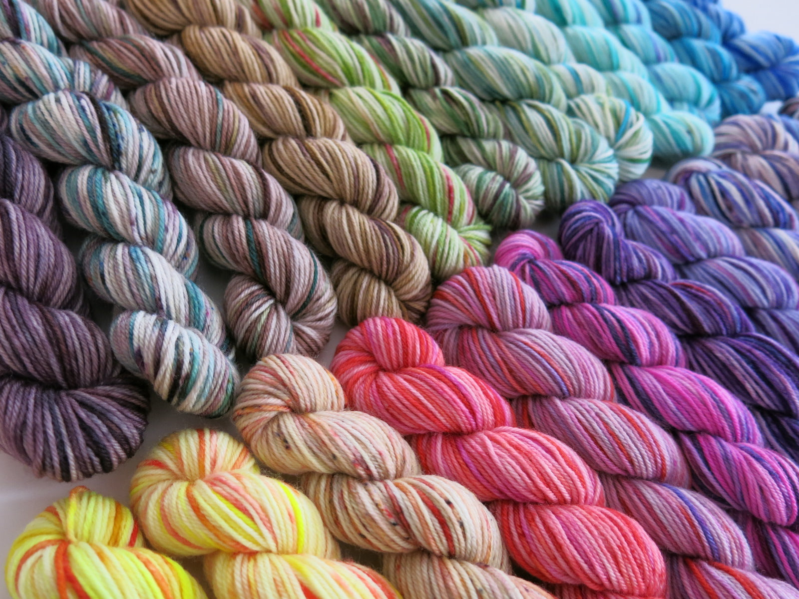 20g indie dyed mini skeins in a speckled rainbow fade