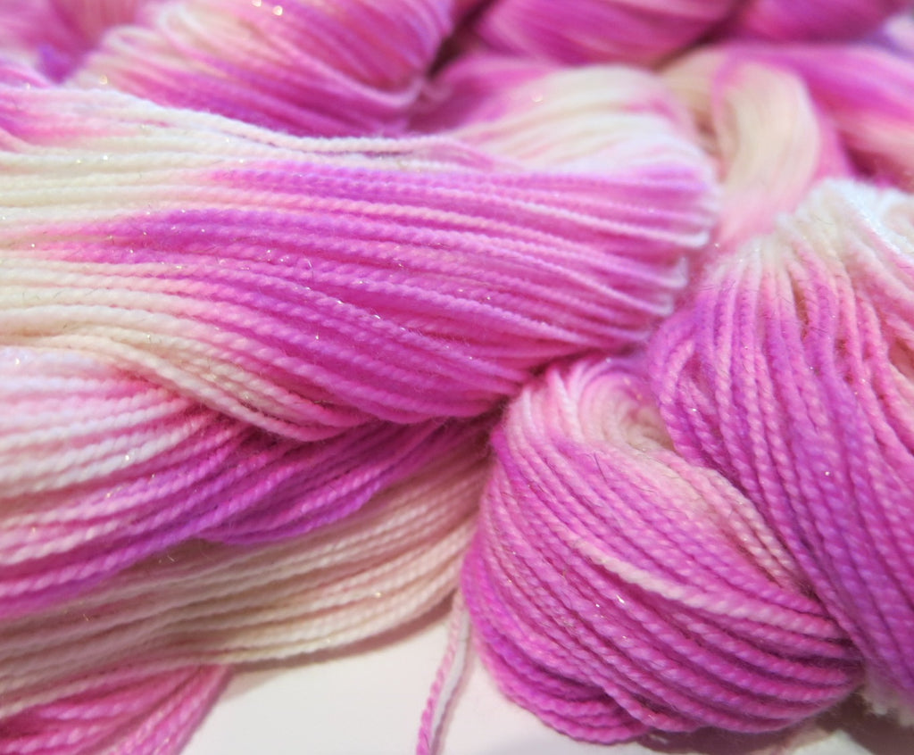hand dyed sparkly uv reactive merino wool by my mama knits