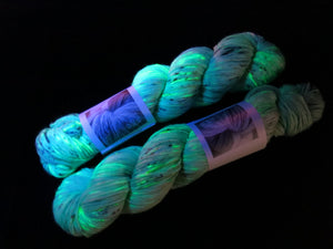 uv reactive green merino yarn fluorescing under black light