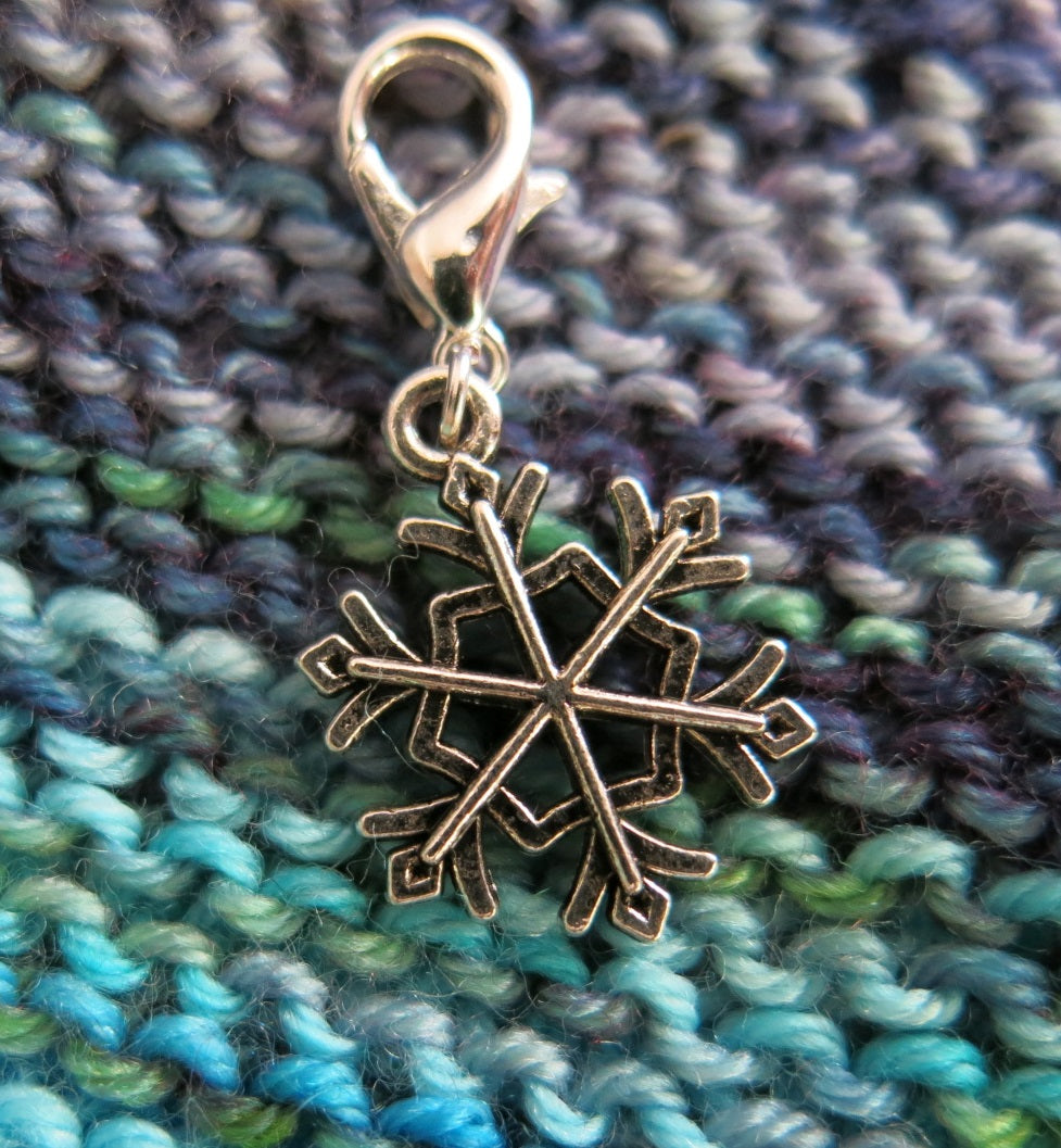 silver snowflake hanging charm with a lobster clasp