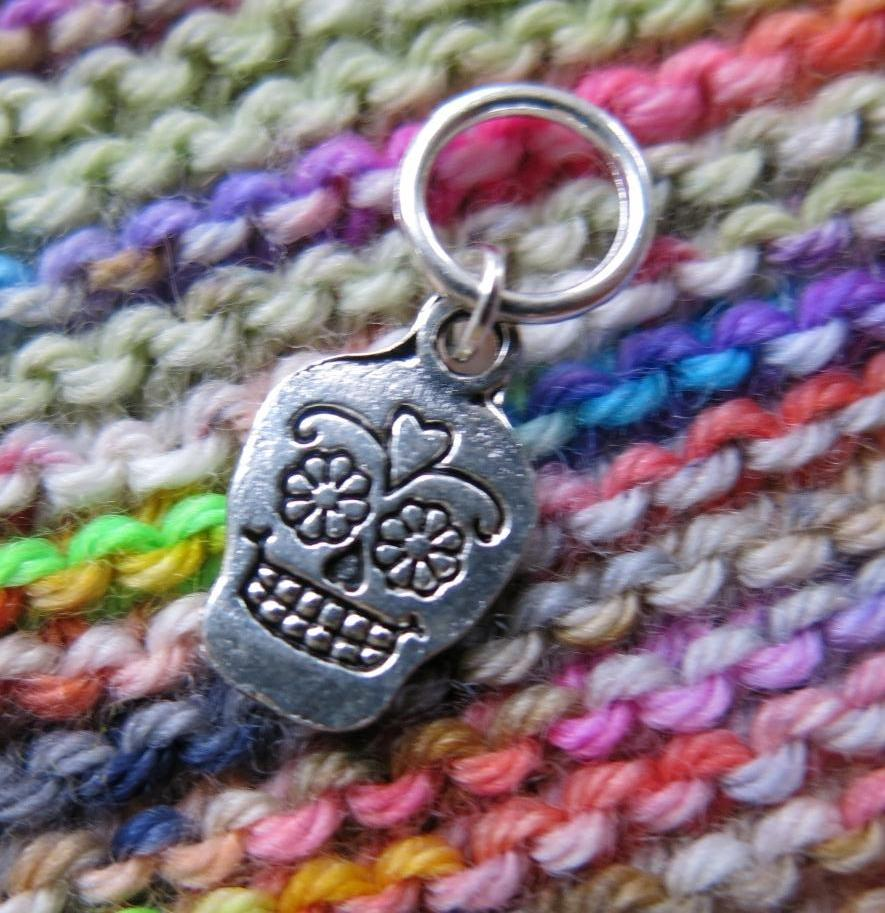 dia de los muertos sugar skull stitch marker on a 10mm jumpring