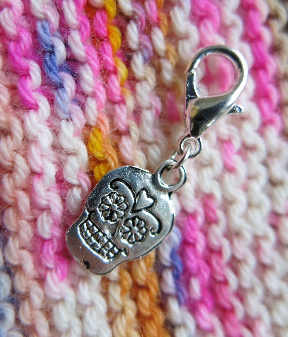 silver sugar skull charm on a lobster clasp for bracelets, crochet and zippers