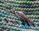 silver fish charm on a snagless ring for knitting projects