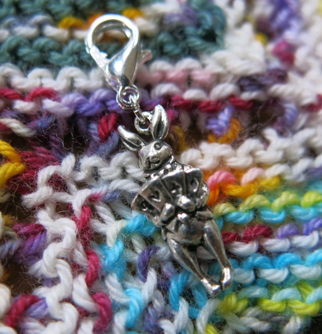 alice in wonderlanf white rabbit charm on a lobster clasp