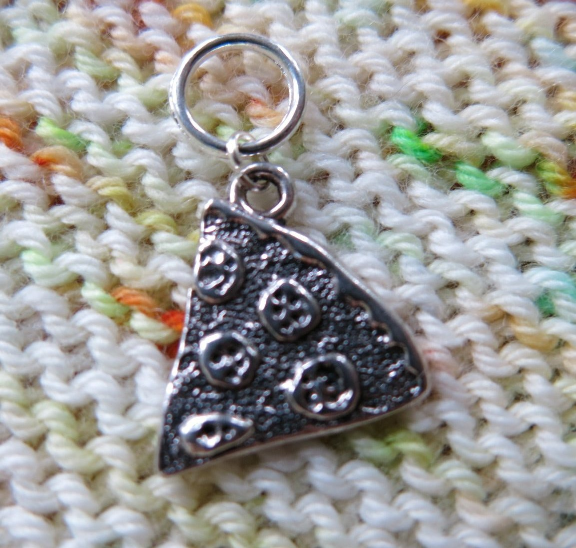 silver pizza slice stitch marker for knitting projects