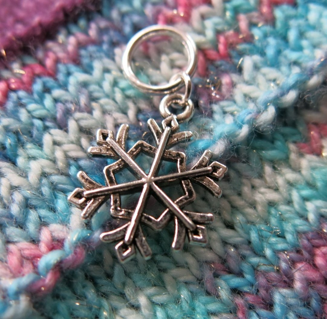 silver snowflake charm on a snagless ring for knitting