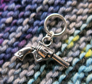 silver pistol gun charm on a snagless ring for knitting