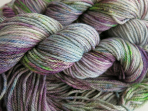 indie dyed purple and green yarn on the chief aran