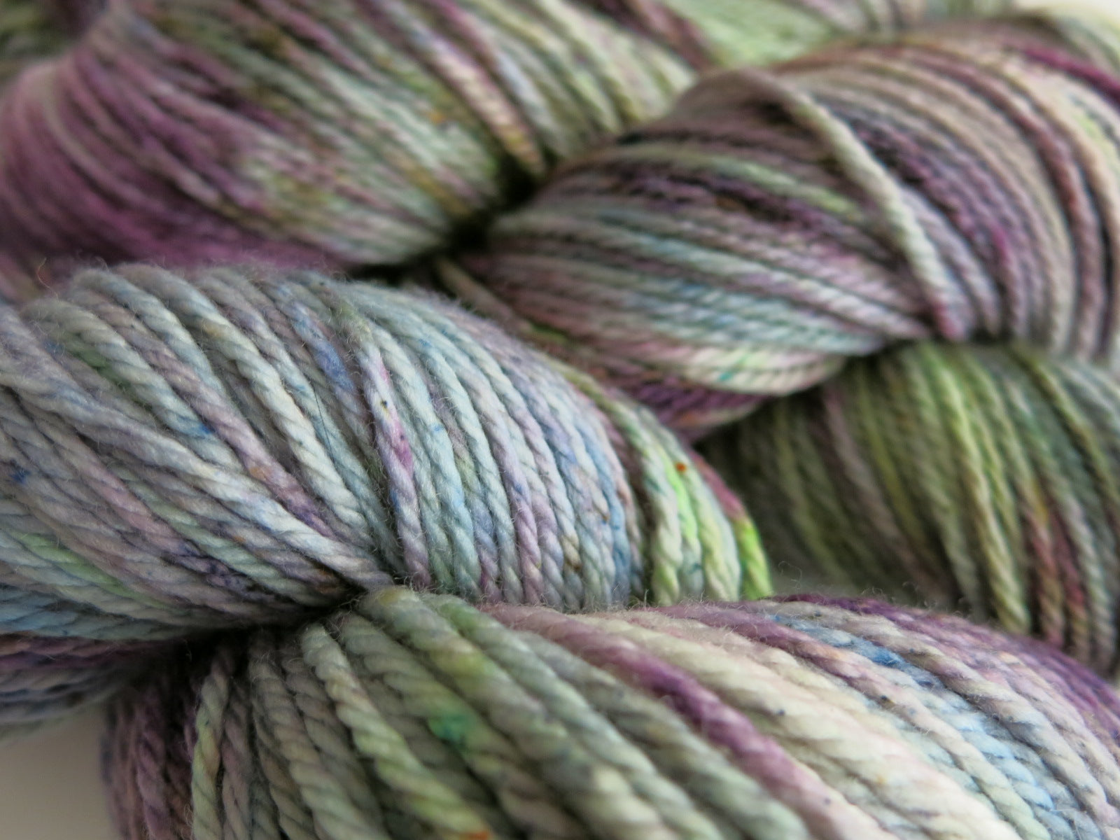speckled purple and green aran wool for hats and scarves