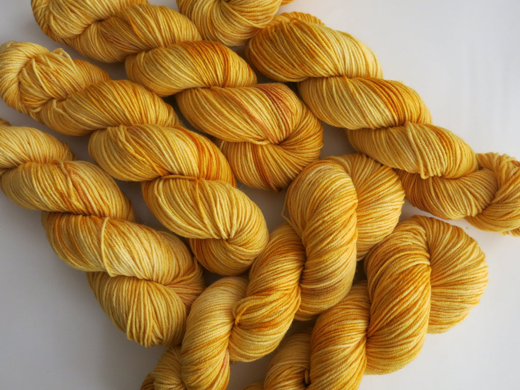 golden mustard yellow 8 ply merino wool 100g skeins