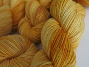 gold yellow indie dyed yarn for knitting sweaters, cardigans and hats