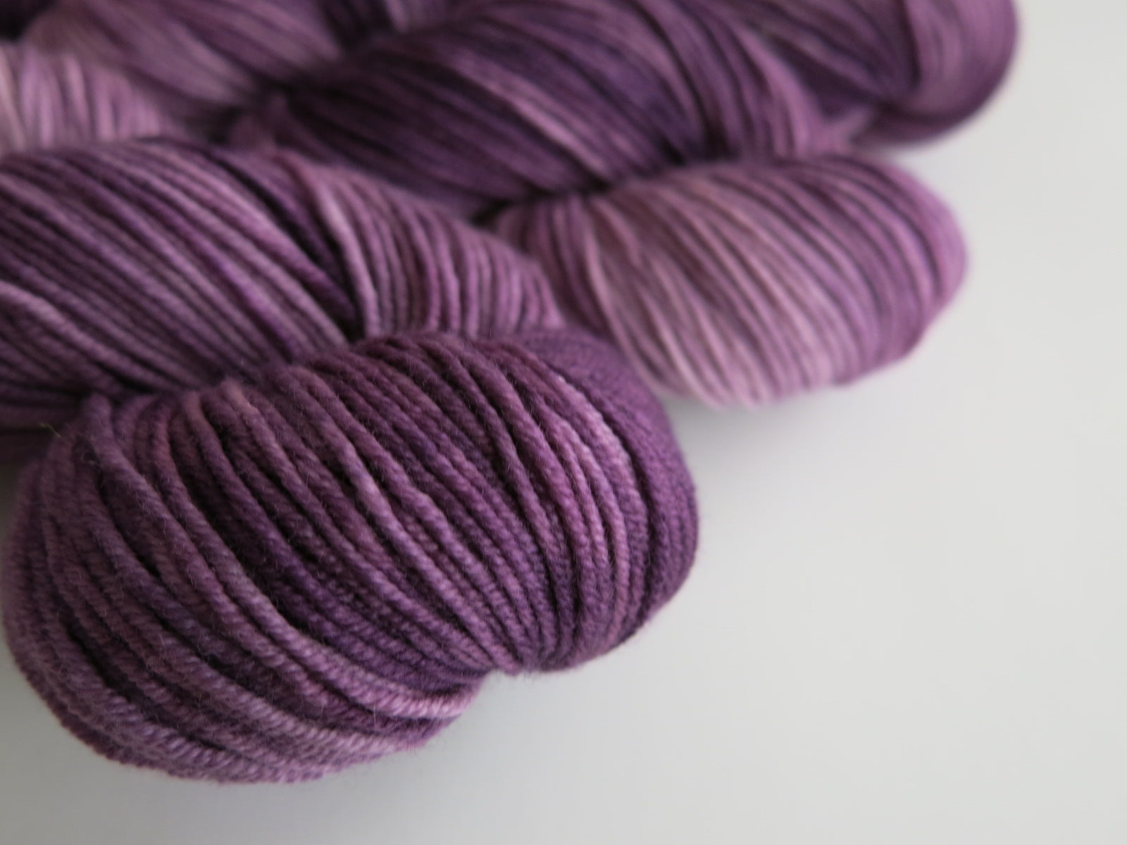 8 ply merino yarn in tonal purple for knitting and crochet