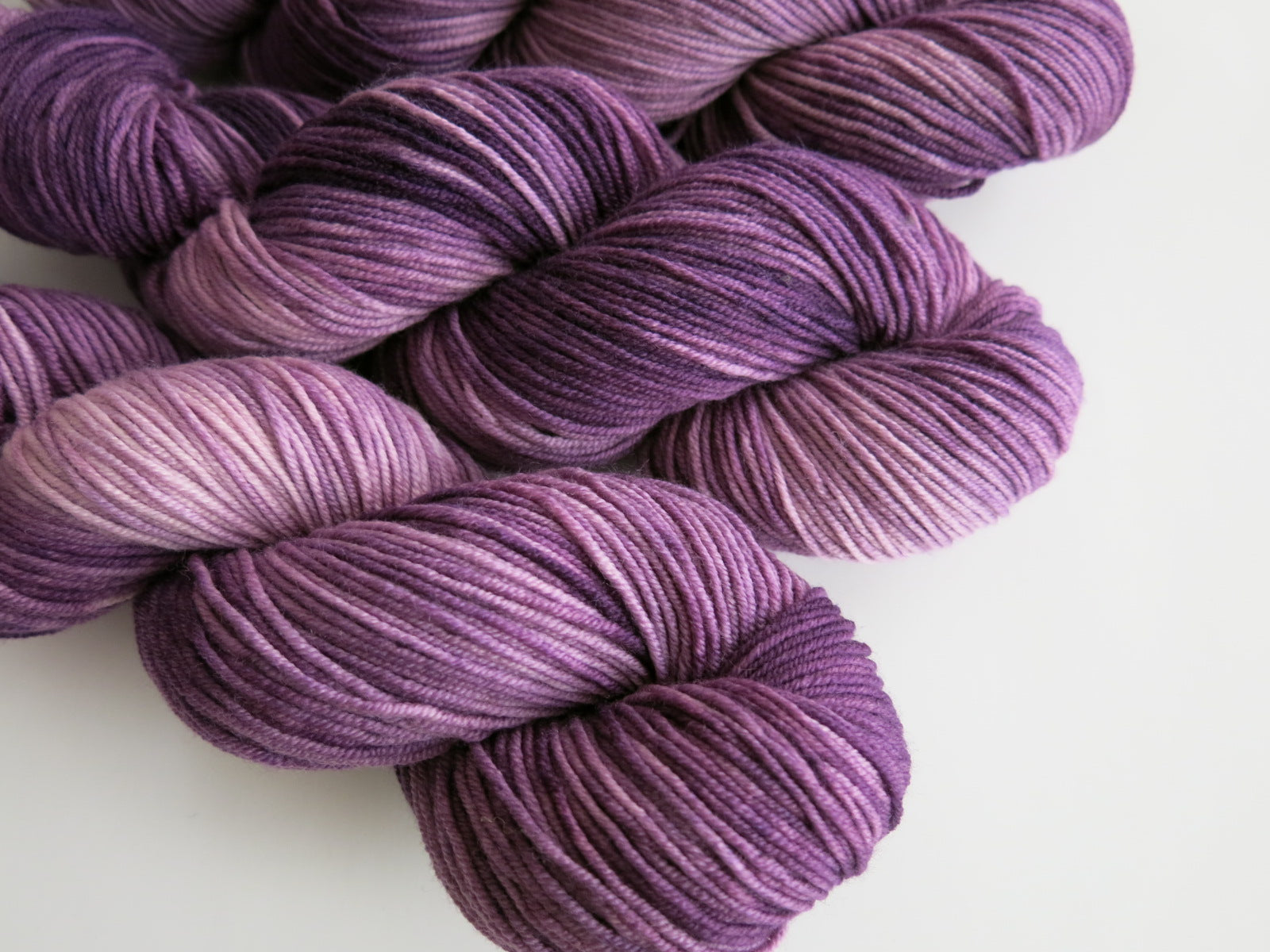 indie dyed purple yarn skeins for knitting ans weaving