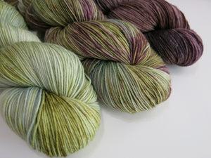 hand dyed yarn fade from green to dark brown