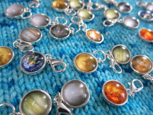 space planet stitch markers and progress keepers for knitting and crochet