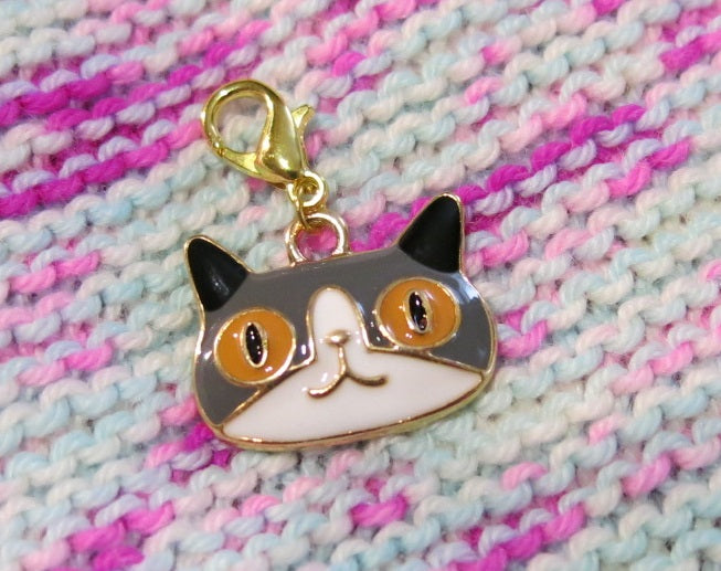 enamel cat charm on a hanging lobster clasp for progress keeping