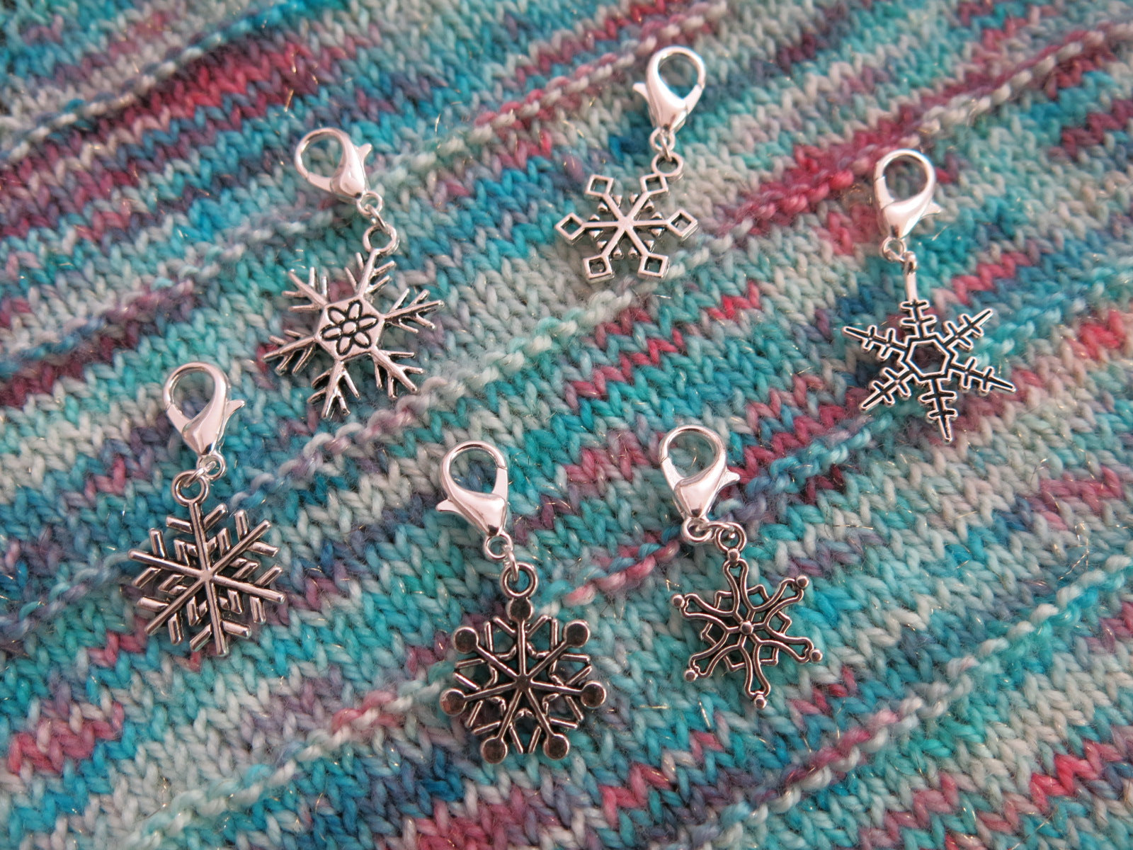 set of snowflake charms on lobster clasps for knitting and crochet