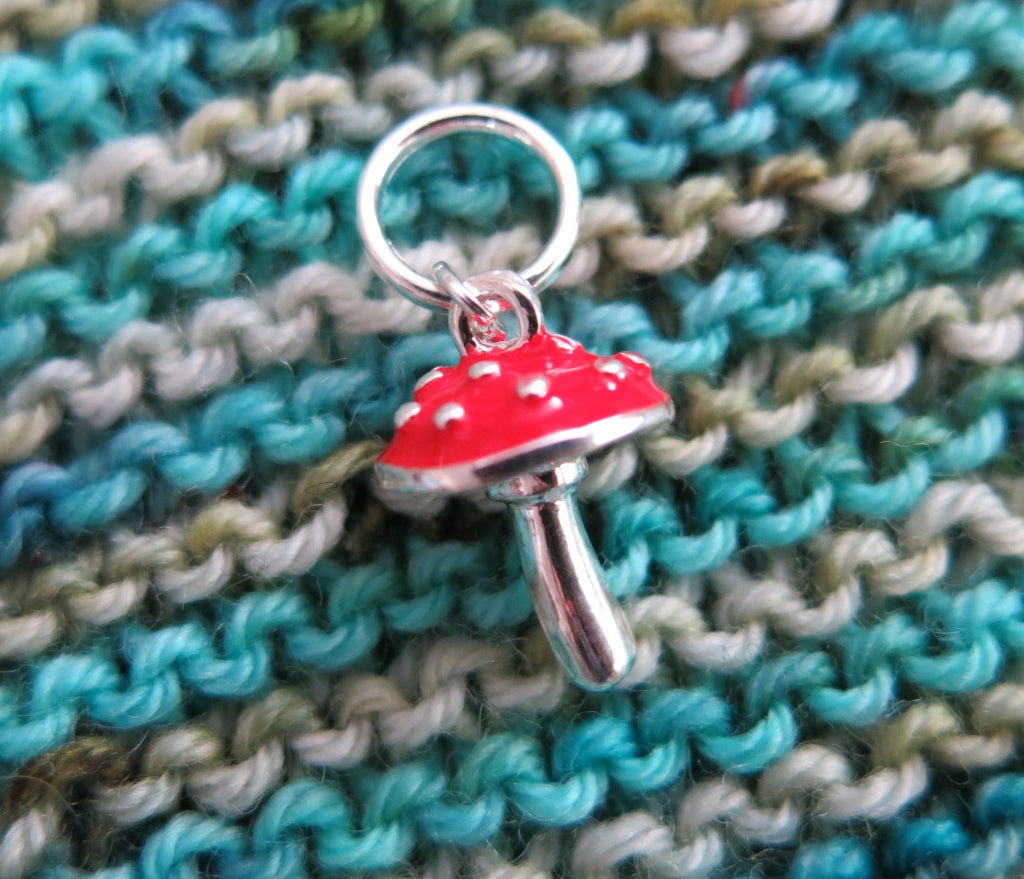 silver and red enamel spotted mushroom stitch marker for knitting