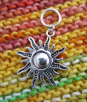 silver hanging sun charm on a snagless jumpring for knitting