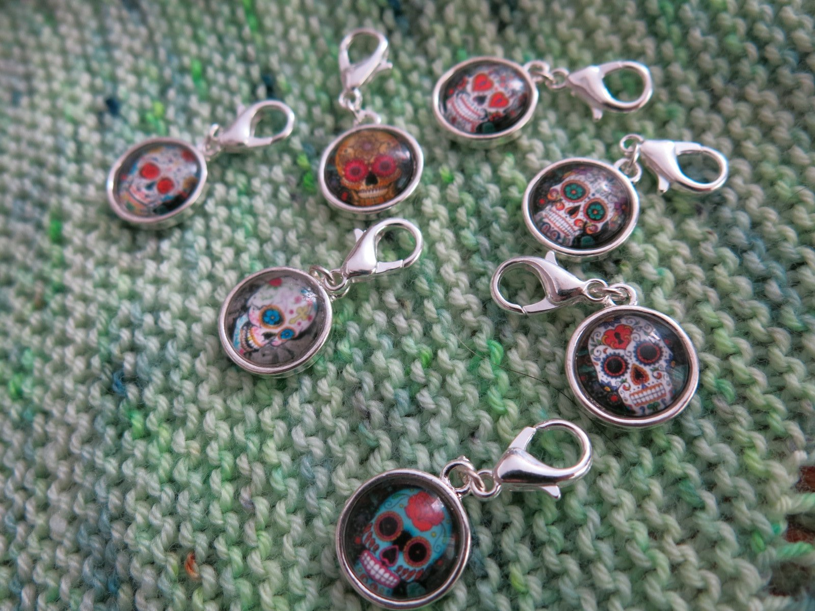 dia de los muertos charms on a clasp for crochet progress keeping
