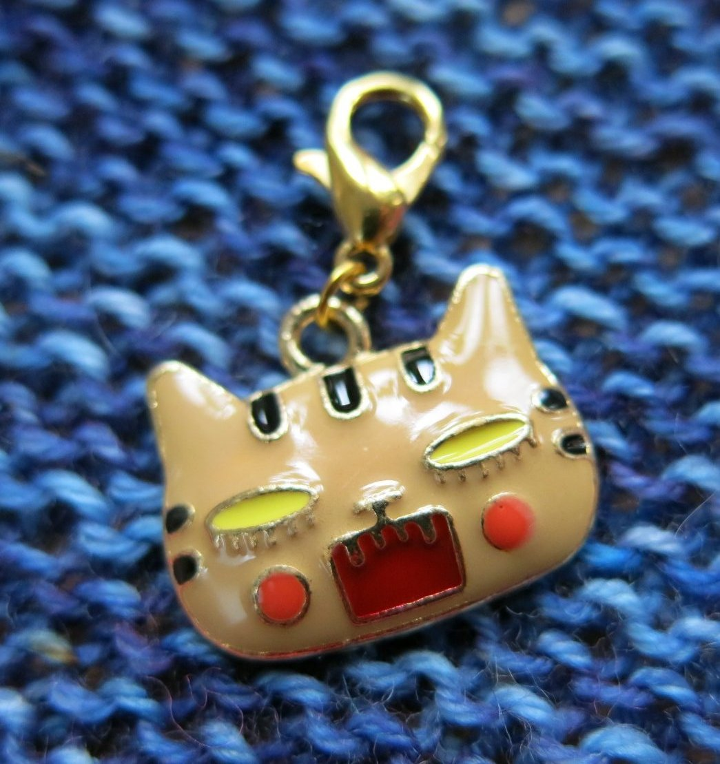 angry cat charm on a hanging clasp for progress keeping and bags