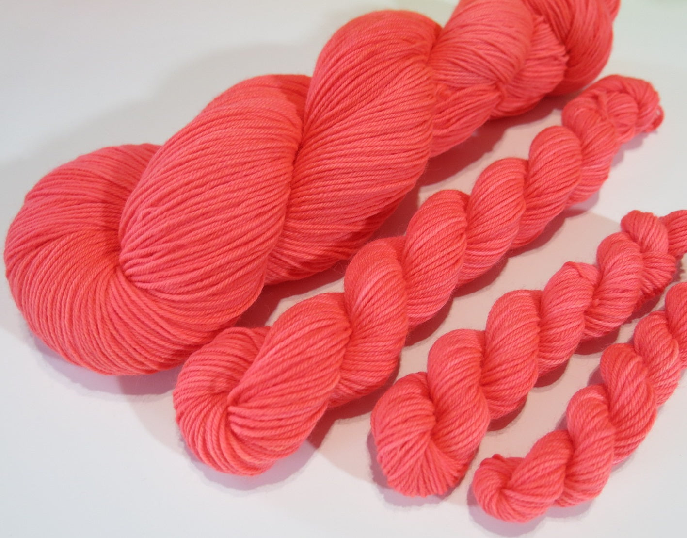 indie dyed uv reactive orange sock yarn for knitting and crochet