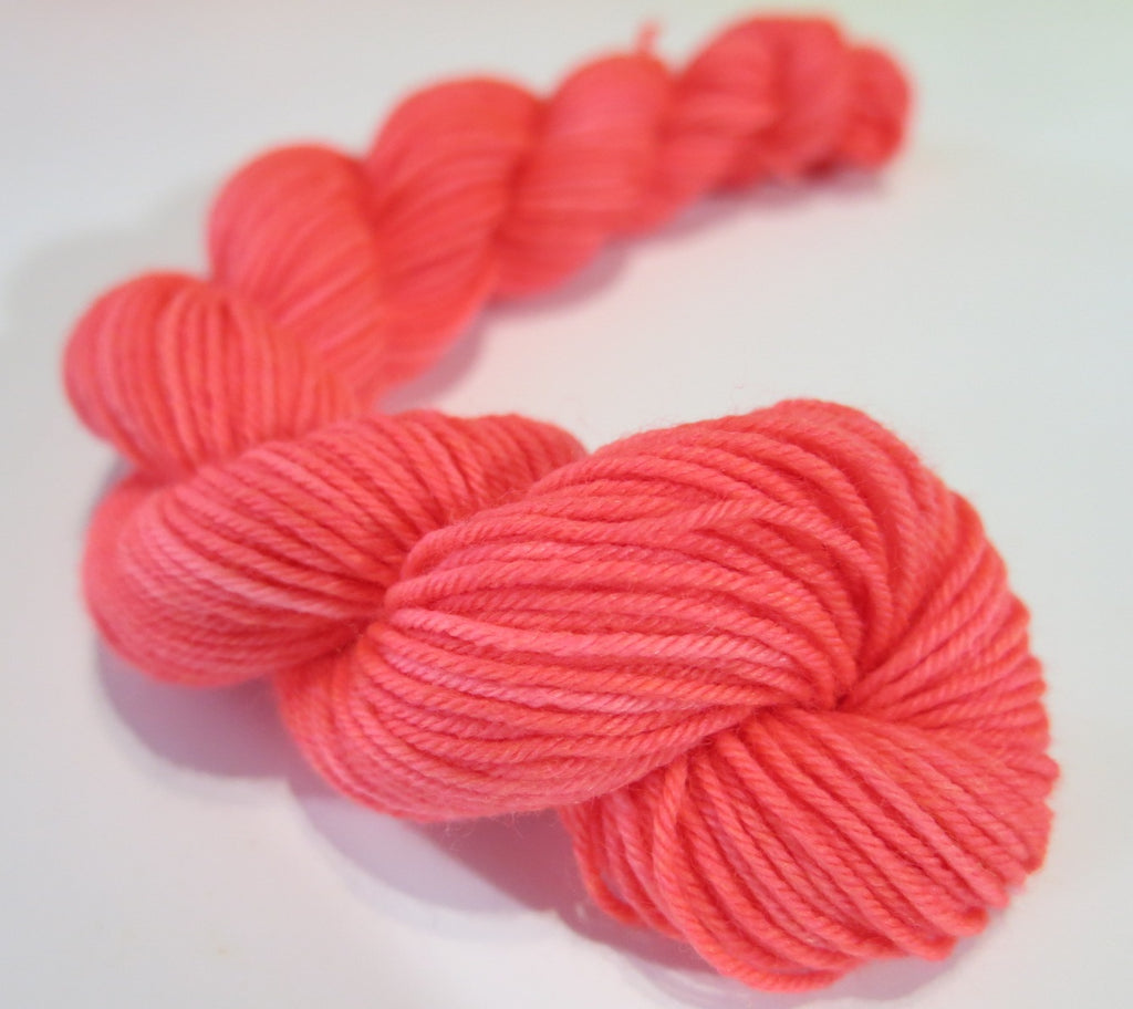 neon coral uv reactive 20g mini yarn skein for knitting and crochet