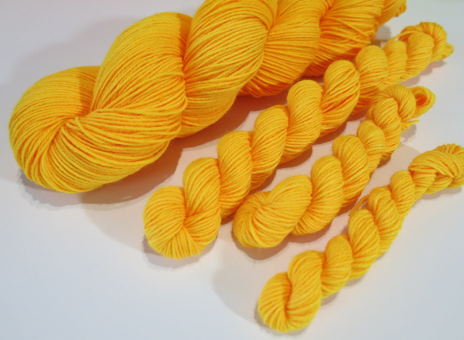 indie dyed orange black light yarn by my mama knits