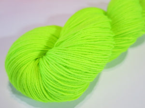 neon green highlighter yellow sock yarn skein for knitting and crochet