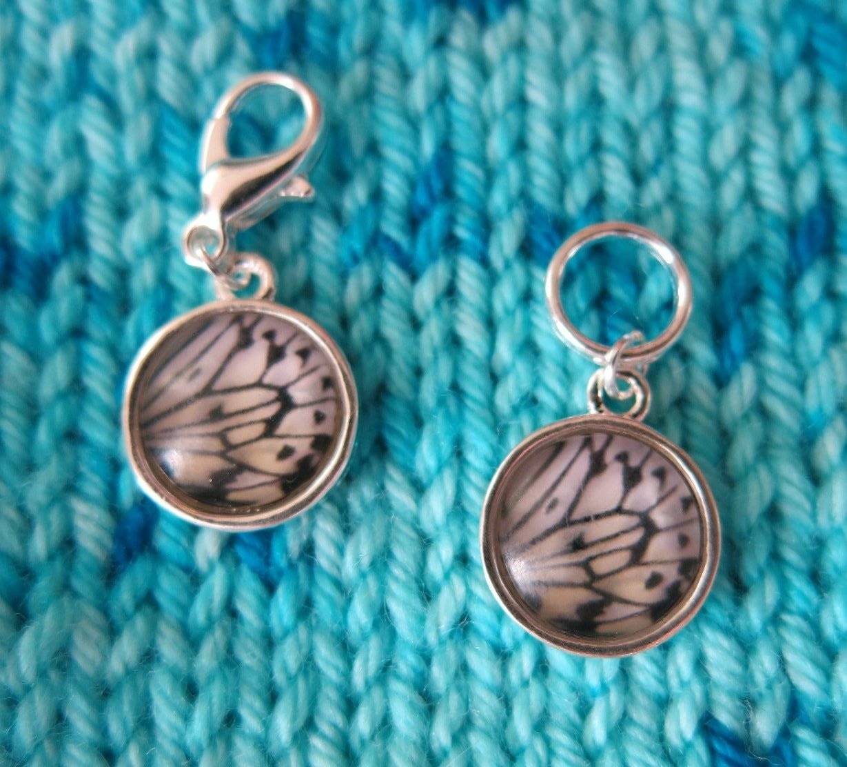 white and pastel yellow butterfly wing stitch markers for knitting and crochet