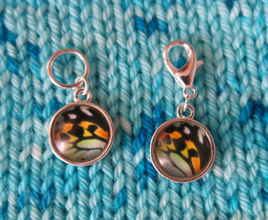 blue yellow and black butterfly wing stitch markers for knitting and crochet