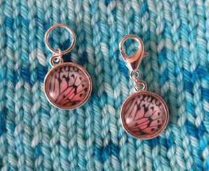 white and pastel pink butterfly wing stitch markers for knitting and crochet