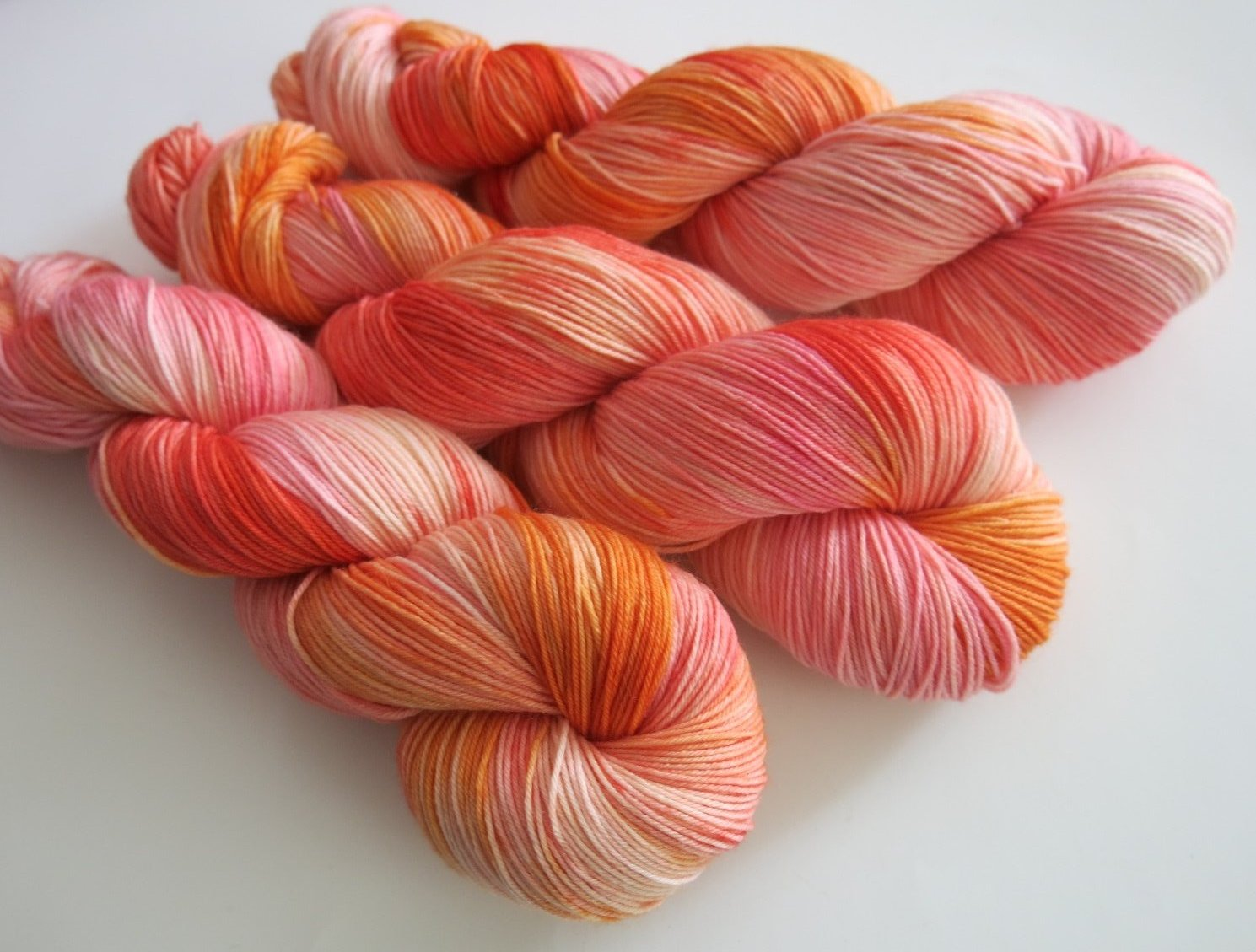 peachy sunset dyed sock yarn for knitting and crochet