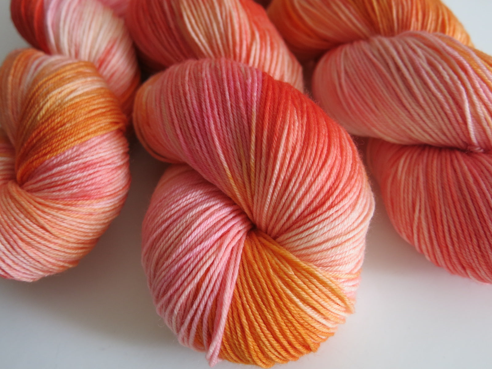kettle dyed merino wool in peaches, orange and pink