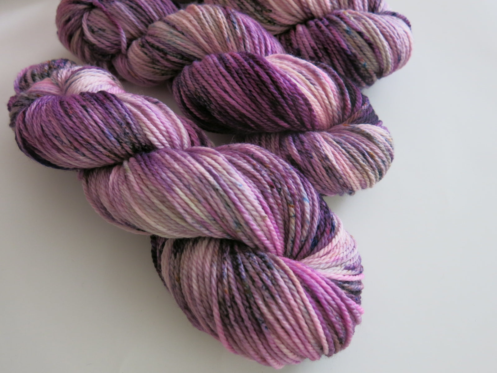 pink and purple kettle dyed yarn in aran by my mama knits