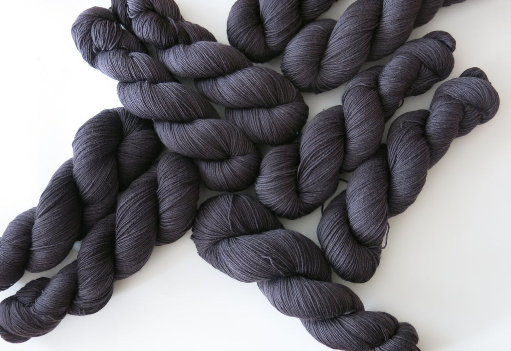hand dyed solid black sock yarn skeins for halloween knitting and crochet