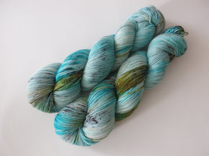 indie dyed speckled turquoise blue sock yarn in 100g skeins