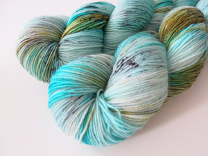hand dyed green and blue speckled merino wool for sock knitting