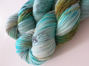 kettle dyed turquoise and speckles sock yarn skein for knitting and crochet