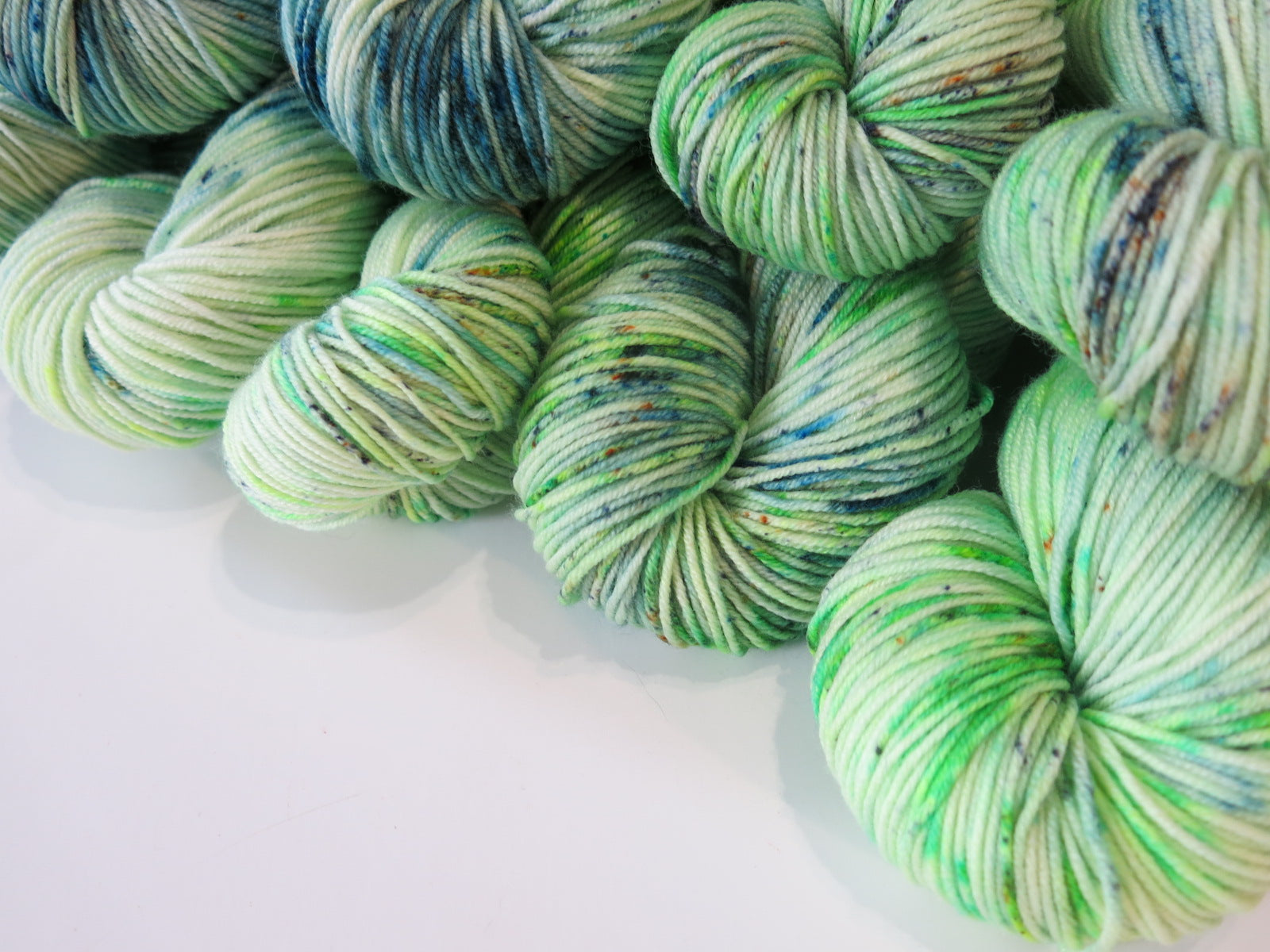 green indie dyed yarn on patsy by my mama knits