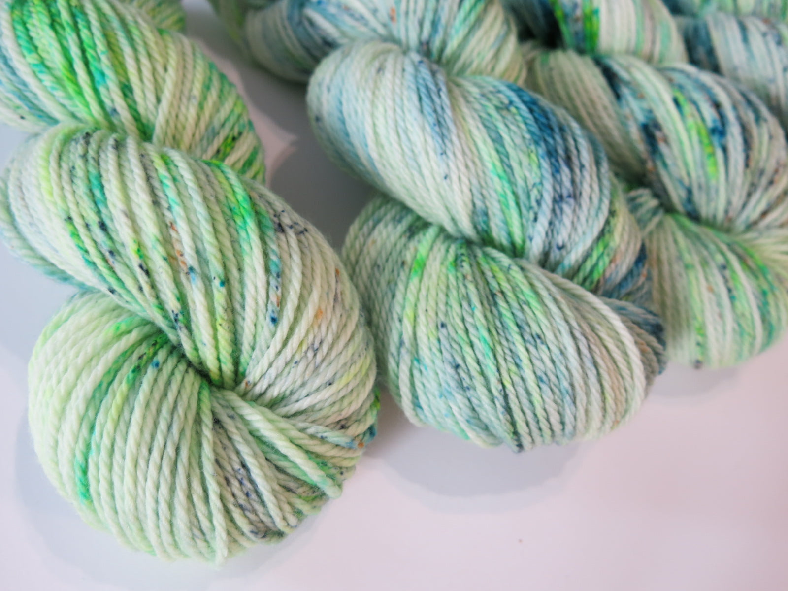 the chief aran yarn by my mama knits in speckled green