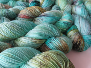 100g skeins of superwash merino and nylon sock yarn in turquoise